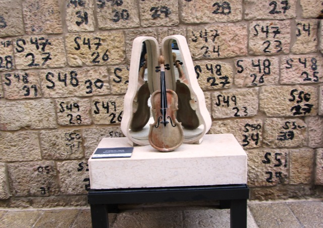 """violin image""  numbered stones of wall image"