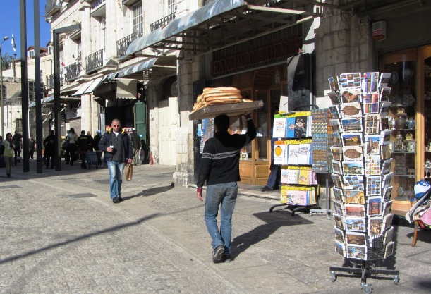 Arab man carrying bread on his head image