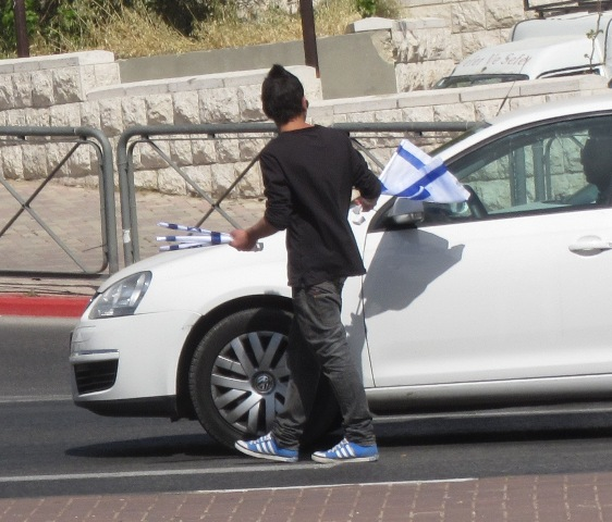 """picture selling flags"", ""image Israeli flag"", ""photo Israeli flag"""