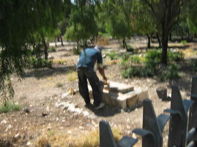 """man working in cemetery"", ""picture of Mamilla Cemetery"""