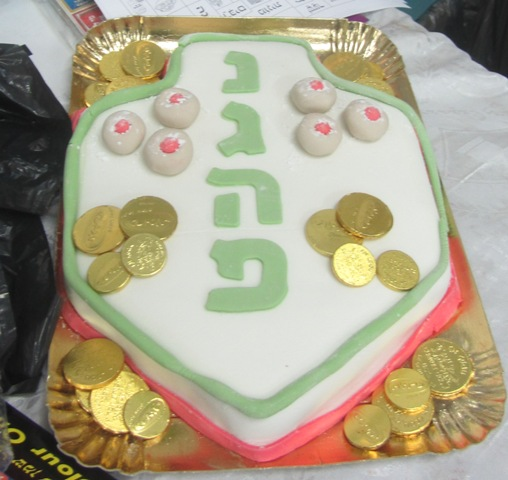 decorated Hanukkah cake, a great miracle happened here, Jerusalem photography tour