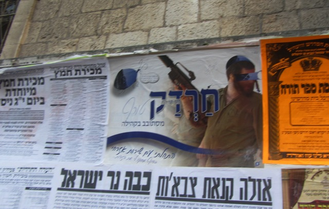 poster against IDF, Jerusalem street sign