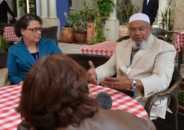 Black Imam with female rabbi