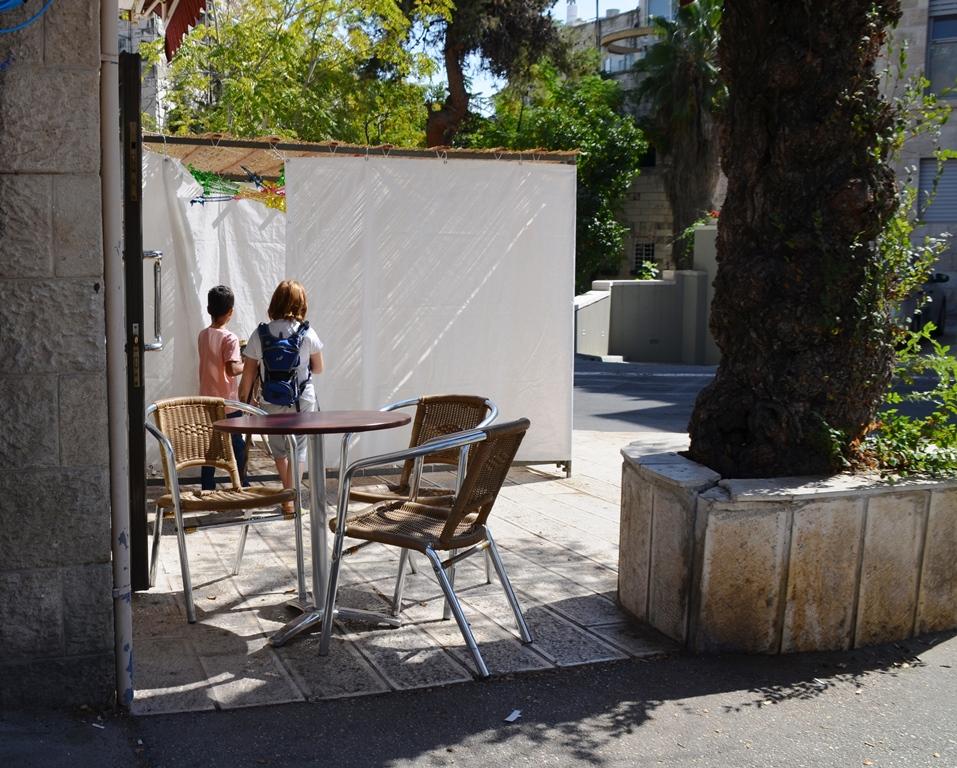 sukka outside of pizza shop Jerusalem