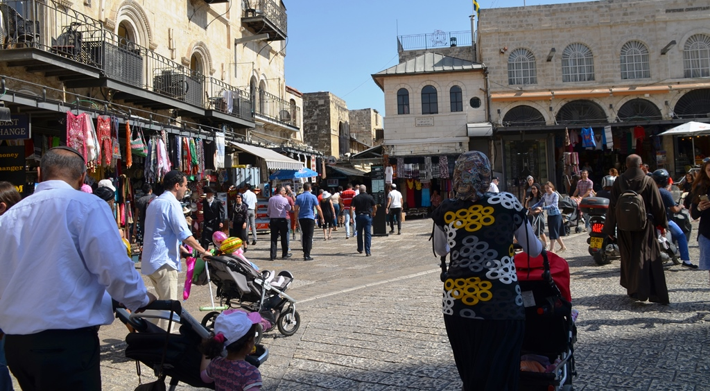People walking near Jaffa Gate on Friday sukkot