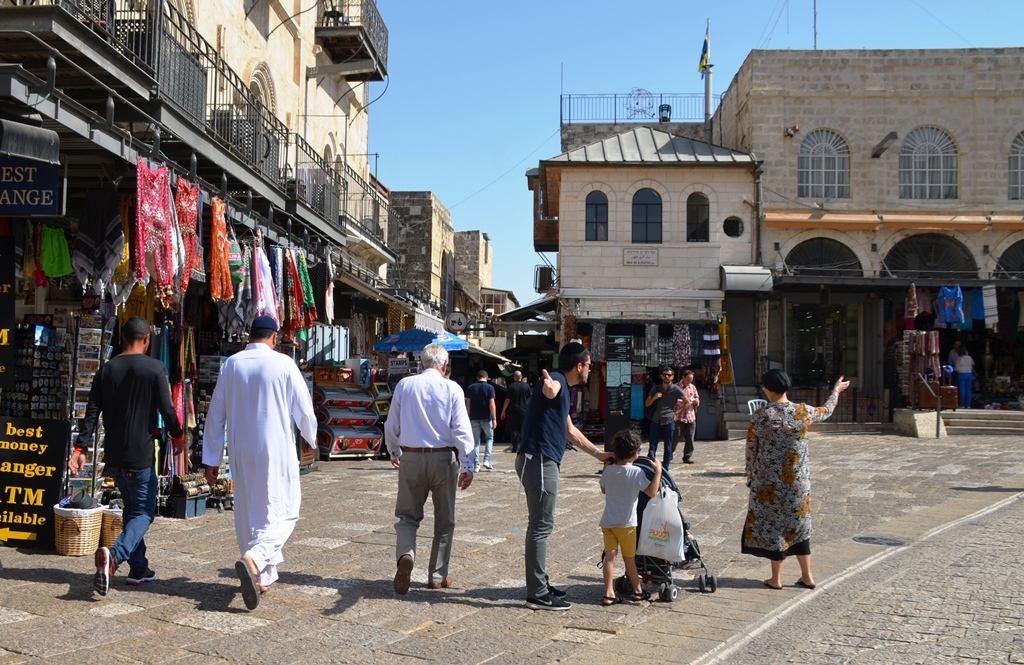 Muslim men going to pray in Old City Friday Sukkot